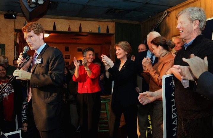 """Joseph Kennedy III, at a campaign rally for Massachusetts Attorney General Martha Coakley (third from left) in 2010, may soon be announcing a political run of his own to replace Rep. Barney Frank, who is retiring from the U.S. House. Mr. Kennedy said he will begin """"to reach out to the people of [Massachusetts' 4th Congressional District] in order to hear directly from them about the challenges they are facing."""" (Associated Press)"""