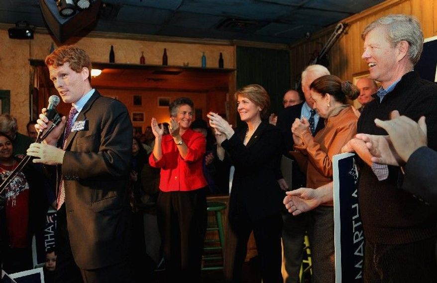 "Joseph Kennedy III, at a campaign rally for Massachusetts Attorney General Martha Coakley (third from left) in 2010, may soon be announcing a political run of his own to replace Rep. Barney Frank, who is retiring from the U.S. House. Mr. Kennedy said he will begin ""to reach out to the people of [Massachusetts' 4th Congressional District] in order to hear directly from them about the challenges they are facing."" (Associated Press)"