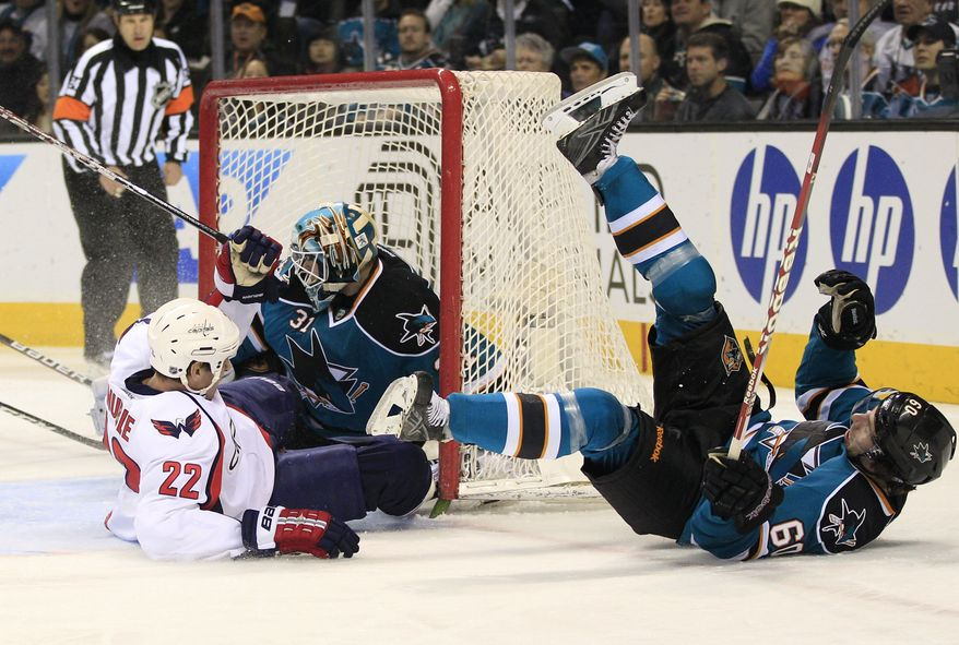 Washington Capitals right wing Mike Knuble (22) collides with San Jose Sharks defenseman Jason Demers (60) in front of goalie Antti Niemi (31) during the first period in San Jose, Calif., on Saturday, Jan. 7, 2012. (AP Photo/Marcio Jose Sanchez)