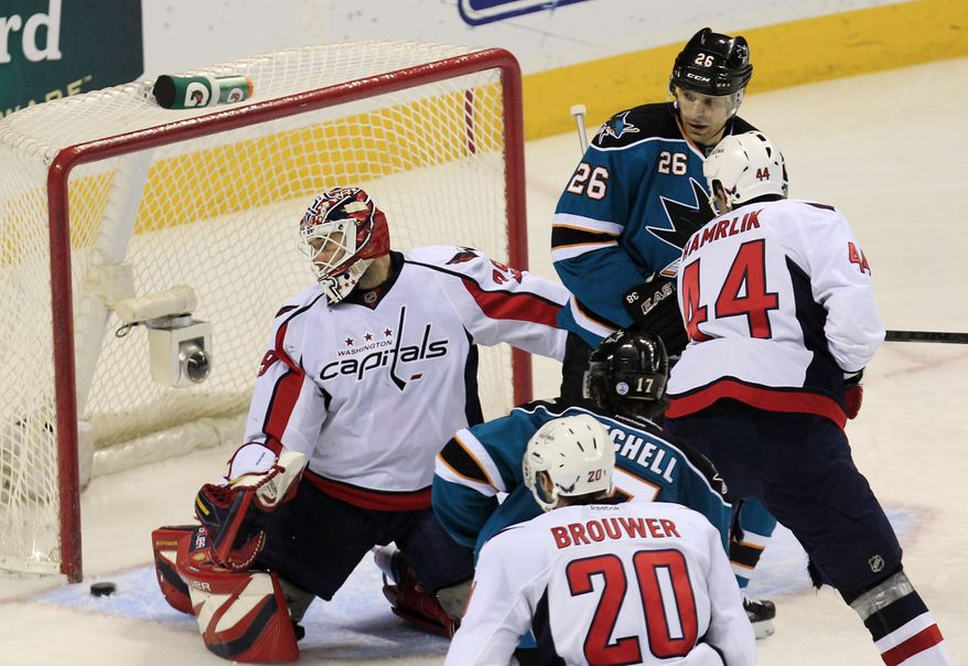 Washington Capitals goalie Tomas Vokoun is beaten for a goal on a shot by San Jose Sharks defenseman Jason Demers during the second period in San Jose, Calif., Saturday, Jan. 7, 2012. (AP Photo/Marcio Jose Sanchez)