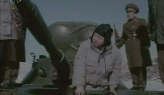 Kim Jong-un, North Korea's new young leader, gets out of a military vehicle at an undisclosed place in North Korea in this image from an undated TV video aired on Sunday, Jan. 8, 2012. (AP Photo/KRT via APTN)