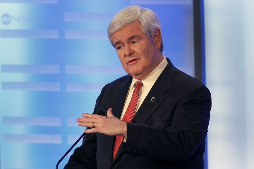 Former House Speaker Newt Gingrich answers a question during a Republican presidential debate at St. Anselm College in Manchester, N.H., on Saturday, Jan. 7, 2012. (AP Photo/Elise Amendola)