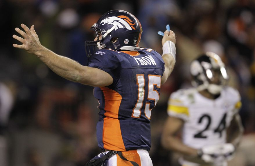 Denver Broncos quarterback Tim Tebow celebrates after throwing an 80-yard touchdown pass to wide receiver Demaryius Thomas for the game-winning touchdown against the Pittsburgh Steelers in overtime Sunday, Jan. 8, 2012, in Denver. The Broncos won 29-23. (AP Photo/Joe Mahoney)