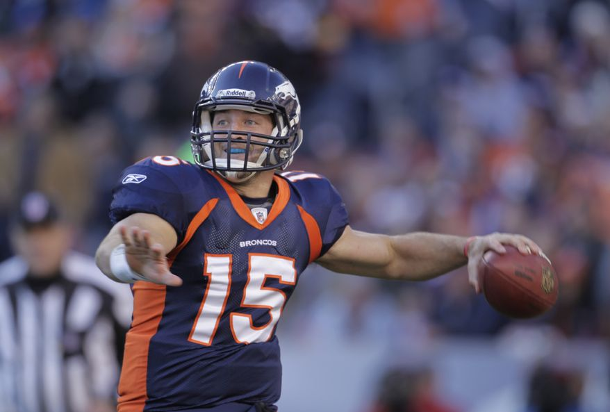 Denver Broncos quarterback Tim Tebow throws against the PIttsburgh Steelers in the second quarter of an NFL wild card playoff game Sunday, Jan. 8, 2012, in Denver. (AP Photo/Joe Mahoney)