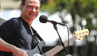Gary Sinise performs with his Lt. Dan Band. He is working to arrange a concert to pay for a home for a Marine who lost both legs and an arm in Afghanistan. (Associated Press)