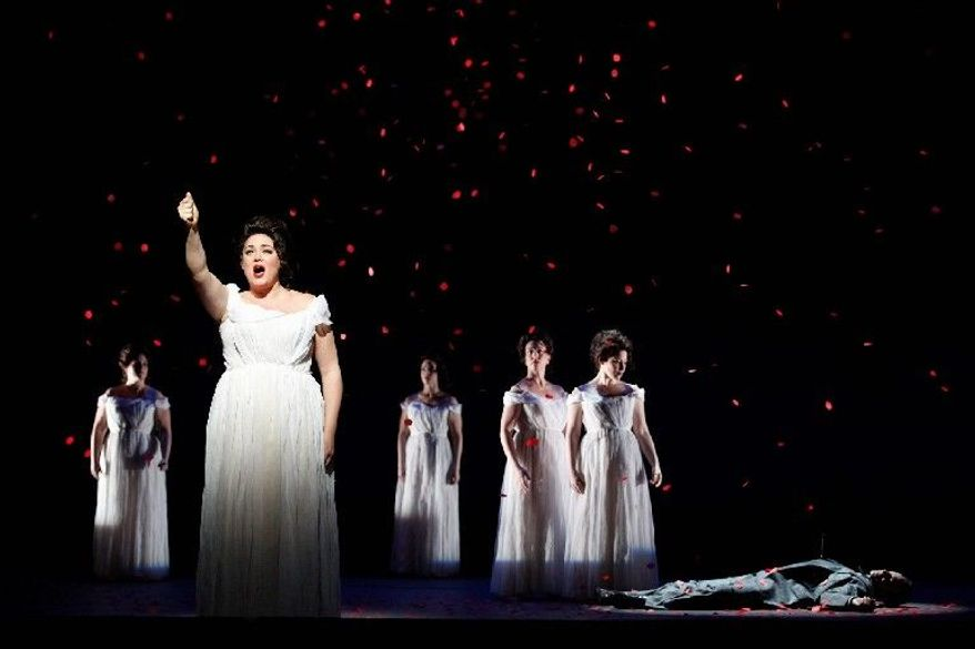 """Kara Shay Thomson performs in Schoenberg's """"Erwartung"""" during the final dress rehearsal in March of the New York City Opera production of """"Monodramas."""" City Opera - which for decades has built daring new productions along with the careers of such stars as Placido Domingo, Renee Fleming and Beverly Sills - is now fighting for its life. A bitter contract dispute has led to a lockout of musicians and could be a possible """"death knell"""" for one of New York's cultural treasures. (New York City Opera via Associated Press)"""