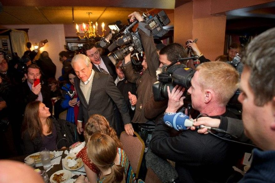 FINAL HOURS: One day before the first presidential primary, Republican Rep. Ron Paul of Texas visits MoeJoe's Family Restaurant in Manchester, N.H. (Rod Lamkey Jr./The Washington Times)