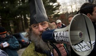The bearded satirist who calls himself Vermin Supreme heckles Republican presidential candidate Rep. Ron Paul after the Texas congressman made a campaign stop at Moe Joe's Family Restaurant in Manchester, N.H., on Monday. (Rod Lamkey Jr./The Washington Times)