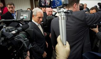 One day before the nation's first presidential primary, Rep. Ron Paul met customers at Moe Joe's Family Restaurant in Manchester, N.H., and then worked his way through a crowd of reporters and camera crews. (Rod Lamkey Jr./The Washington Times)