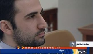 ** FILE ** U.S. citizen Amir Mirzaei Hekmati, convicted by Iran of spying for the CIA, is pictured on a video frame grab image made from the Iranian broadcaster IRIB TV on Tuesday, Dec. 24, 2011. (AP Photo/IRIB)