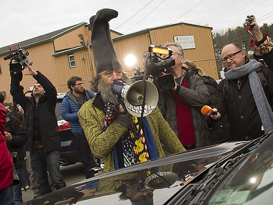 Performance artist Vermin Supreme heckles Rep. Ron Paul after Mr. Paul made a presidential campaign stop at Moe Joe's Family Restaurant in Manchester, N.H., on Monday, Jan. 9, 2012. (Rod Lamkey Jr./The Washington Times)