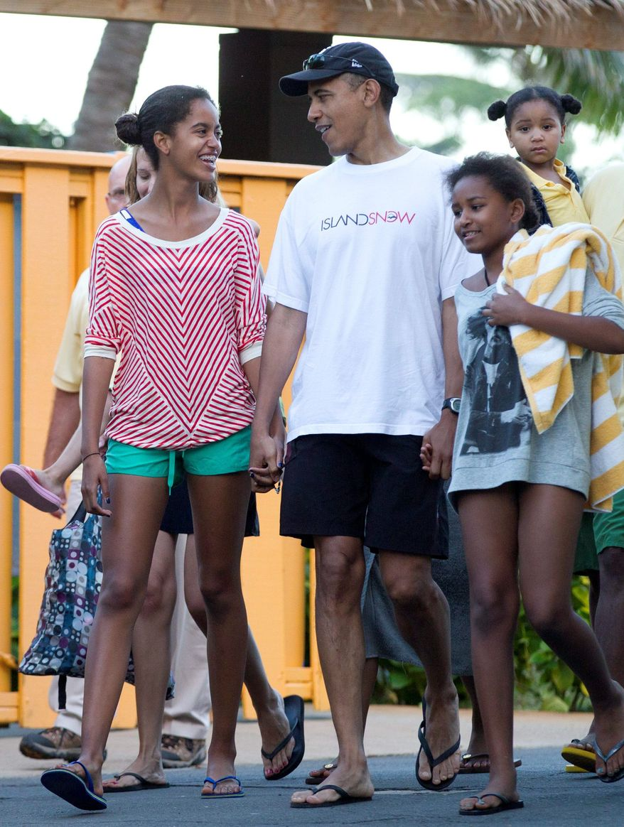President Obama holds hands with his daughters Malia (left) and Sasha as they leave Sea Life Park, a marine wildlife park, with family friends on Dec. 27 in Waimanalo, Hawaii. (Associated Press)
