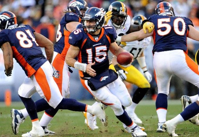 Denver quarterback Tim Tebow passed for 316 yards and two touchdowns and also ran for 50 yards and another score in Sunday's 29-23 overtime victory over Pittsburgh. (Associated Press)