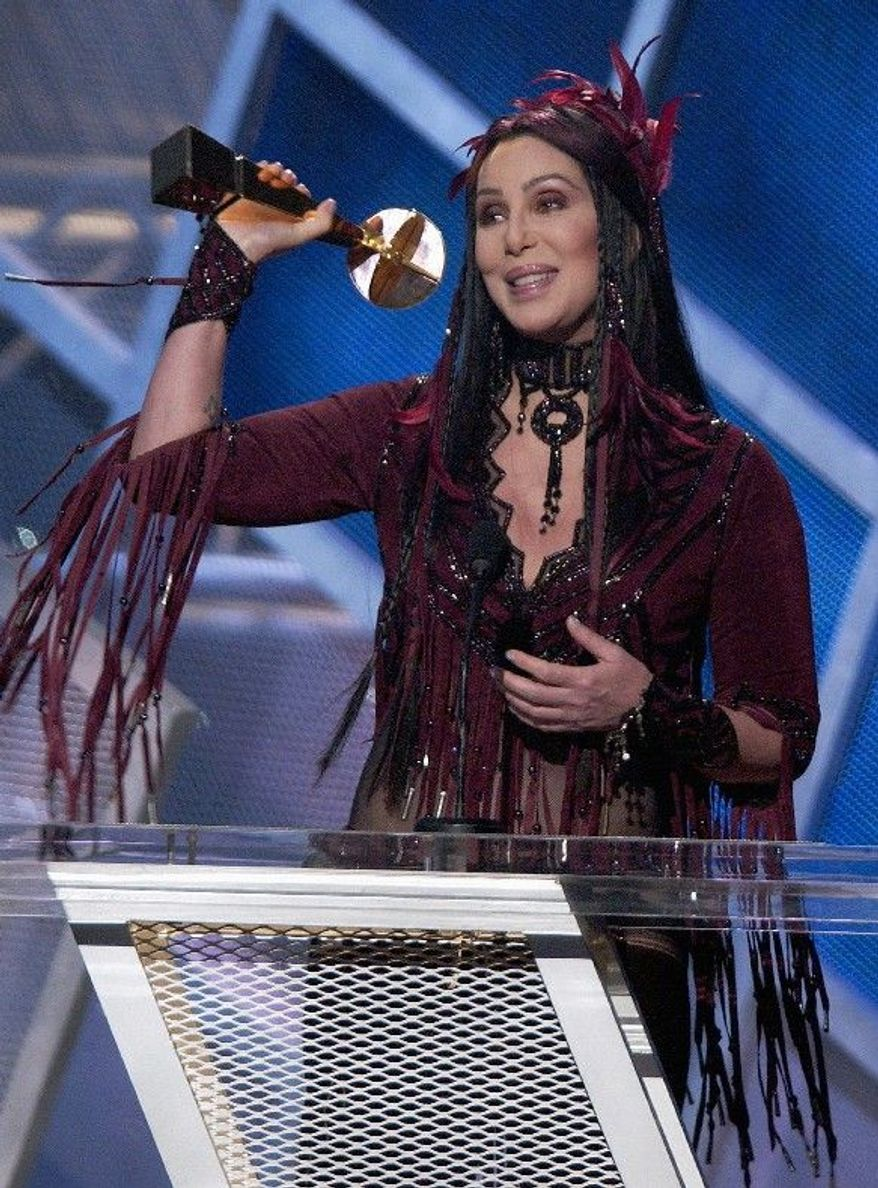 Cher accepts a lifetime achievement award in Las Vegas during the Billboard Music Awards show in 2002. During the show, Cher used the F-word. The Supreme Court began hearing arguments on Tuesday in a First Amendment case that pits the Obama administration against the nation's television networks. (Associated Press)