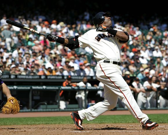 Barry Bonds holds the all-time record for home runs with 762 and the record for most in a season, 73. He also was convicted of obstruction of justice for giving an evasive answer to a grand jury investigating drug distribution. (Associated Press)