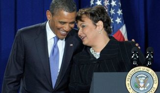 **FILE** President Obama talks with Environmental Protection Agency Administrator Lisa Jackson on Jan. 10, 2012, at EPA headquarters. (Associated Press)
