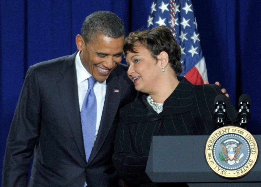**FILE** President Obama talks with Environmental Protection Agency Administrator Lisa Jackson on Jan. 10, 2012, at EPA headquarters. (Associated Press)