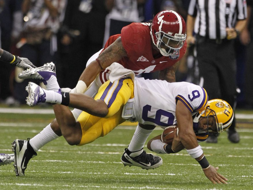 LSU quarterback Jordan Jefferson (9) is tackled by Alabama's Mark Barron during the second half of the BCS National Championship college football game Monday, Jan. 9, 2012, in New Orleans. (AP Photo/Dave Martin)