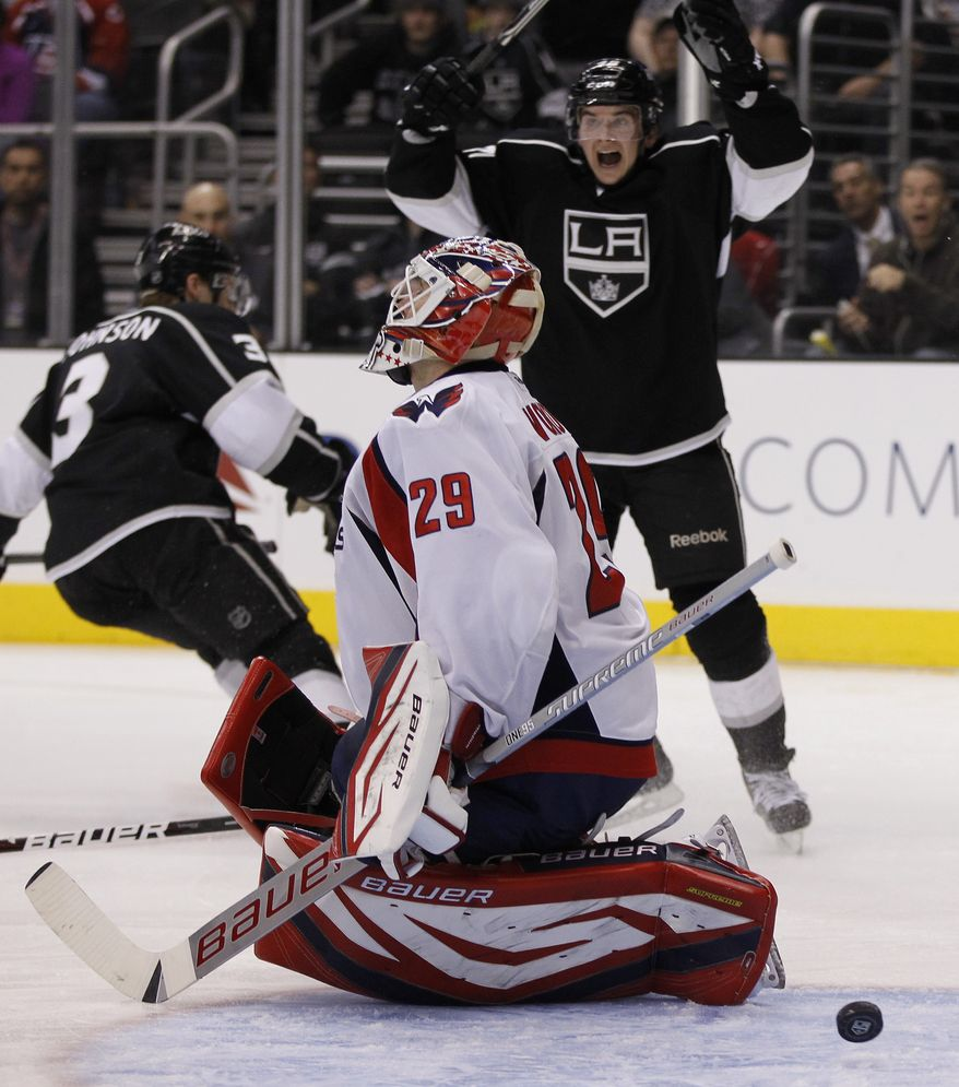 Washington Capitals goalie Tomas Vokoun allowed four goals on 27 shots against the Los Angeles Kings before being pulled after two periods. The Caps lost 5-2. (AP Photo/Chris Carlson)