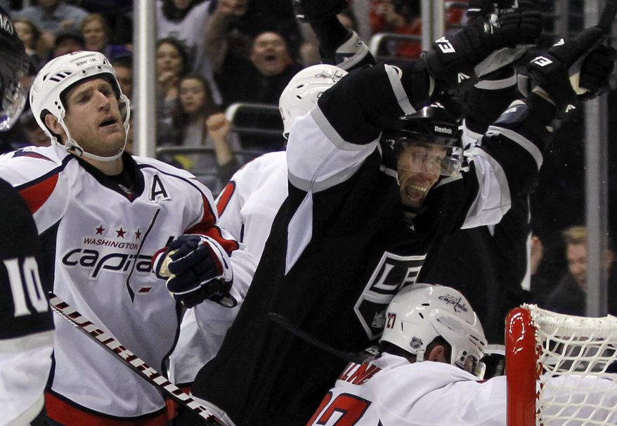 Los Angeles Kings center Jarret Stoll, right, celebrates his goal as Washington Capitals center Brooks Laich reacts during the second period of an NHL game in Los Angeles, Monday, Jan. 9, 2012. (AP Photo/Chris Carlson)