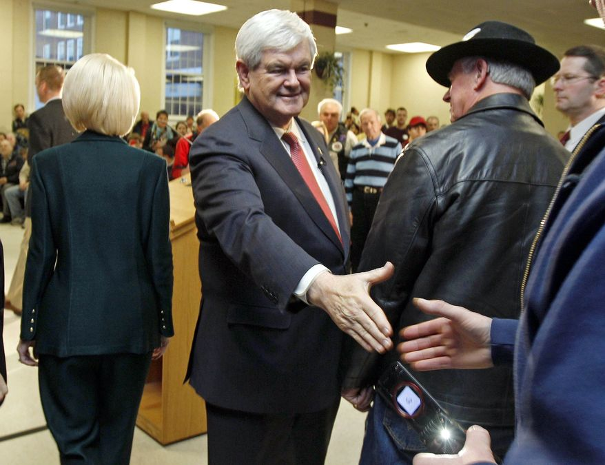 Republican presidential candidate former House Speaker Newt Gingrich shakes hands during a campaign stop in Hudson, N.H., Monday, Jan. 9, 2012. (AP Photo/Charles Krupa)