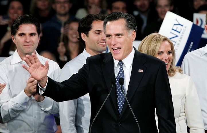 ** FILE ** Former Massachusetts Gov. Mitt Romney waves to supporters at the Romney for President New Hampshire primary night rally at Southern New Hampshire University in Manchester, N.H., on Tuesday, Jan. 10, 2012. Behind Mr. Romney are his sons Tagg (left) and Craig and his wife, Ann. (AP Photo/Elise Amendola)