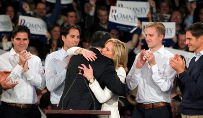 Former Massachusetts Gov. Mitt Romney hugs his wife Ann as his sons, Tagg, Craig, Ben and Josh (L-R) look on during the Romney for President New Hampshire primary night victory party at Southern New Hampshire University in Manchester, N.H., Tuesday, Jan. 10, 2012. (AP Photo/Elise Amendola)