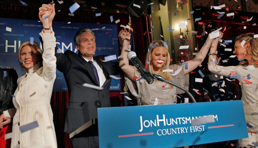 Republican presidential candidate, former Utah Gov. Jon Huntsman raises hands with his family during a New Hampshire Primary night party in Manchester, N.H., Tuesday Jan. 10, 2012. (AP Photo/Charles Krupa)