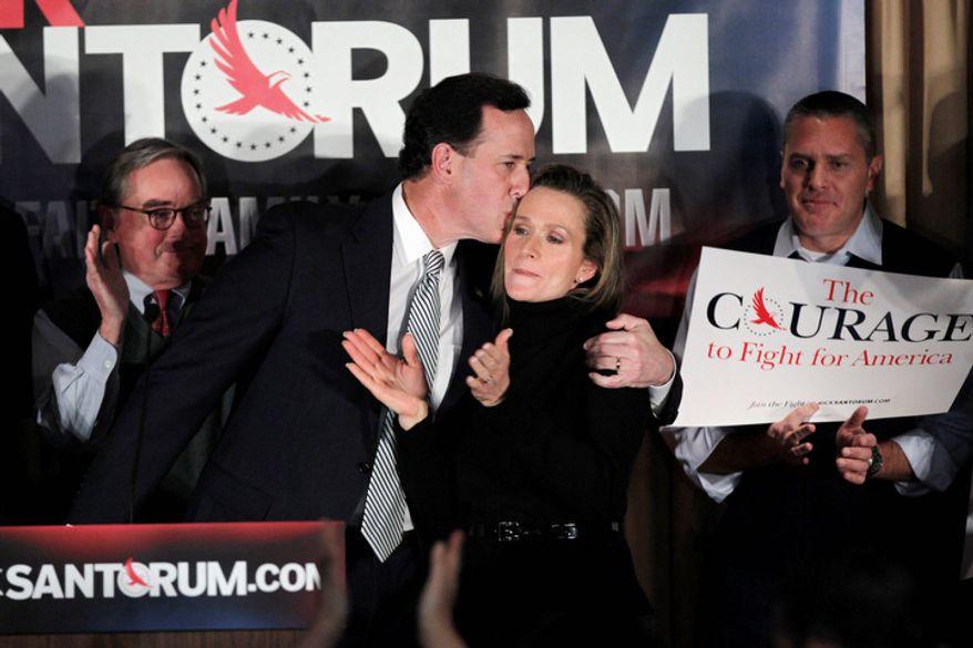 Republican presidential candidate former Pennsylvania Sen. Rick Santorum kisses his wife Karen during a primary night rally, Tuesday, Jan. 10, 2012, in Manchester, N.H. (AP Photo/Matt Rourke)