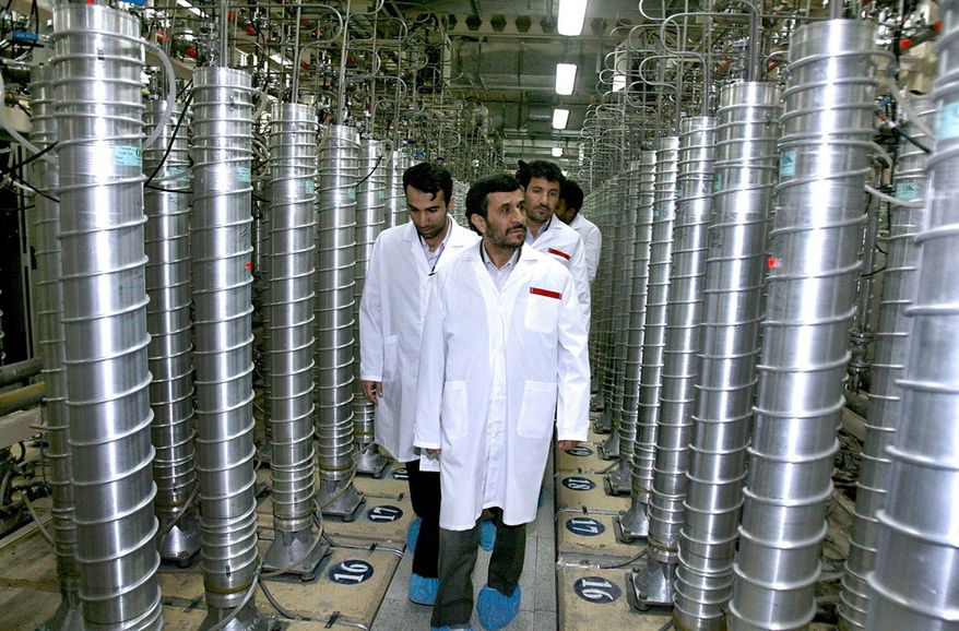 ** FILE ** In this April 8, 2008, file photo provided by the Iranian President's Office, Iranian President Mahmoud Ahmadinejad, center, visits the Natanz Uranium Enrichment Facility some 200 miles (322 kilometers) south of the capital Tehran. Iran has begun uranium enrichment at a new underground site well protected from possible airstrikes, a leading hardline newspaper reported Sunday, Jan. 8, 2011. (AP Photo/Iranian President's Office, File)