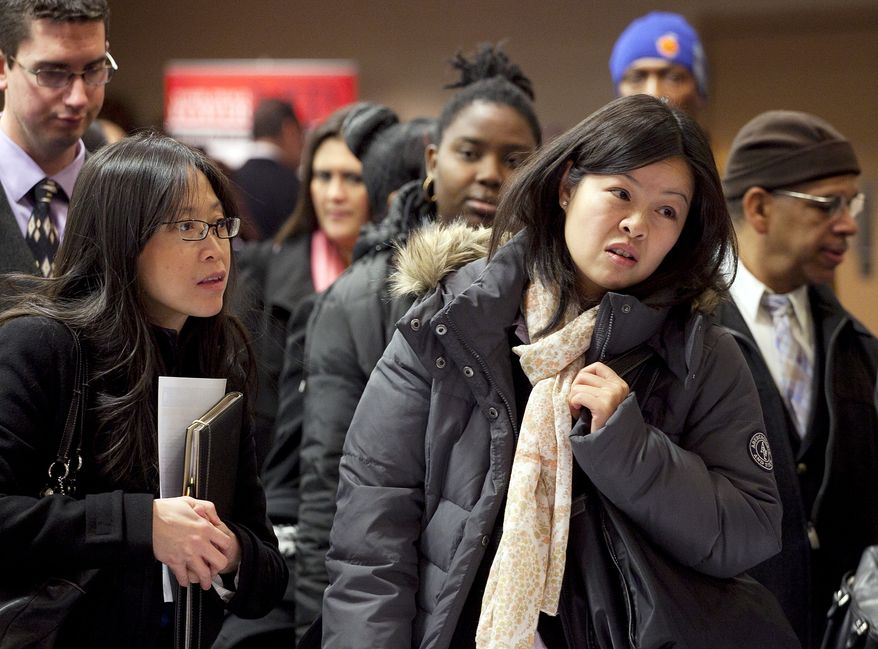 Job-seekers wait to talk with potential employers at a job fair sponsored by National Career Fairs on Monday, Dec. 12, 2011, in New York. (AP Photo/Mark Lennihan)