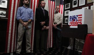 Dixville Notch, N.H., residents (from left) Tanner Tillotson, Peter Johnson and Jacques Couture wait on Monday, Jan. 9, 2012, at the Balsams Grand Resort for the stoke of midnight to cast their votes in the first-in-the-nation presidential primary. (AP Photo/Matt Rourke)