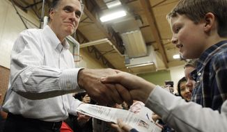 Former Massachusetts Gov. Mitt Romney campaigns for the Republican presidential nomination at McKelvie Intermediate School in Bedford, N.H., on Monday, Jan. 9, 2012. (AP Photo/Charles Dharapak)