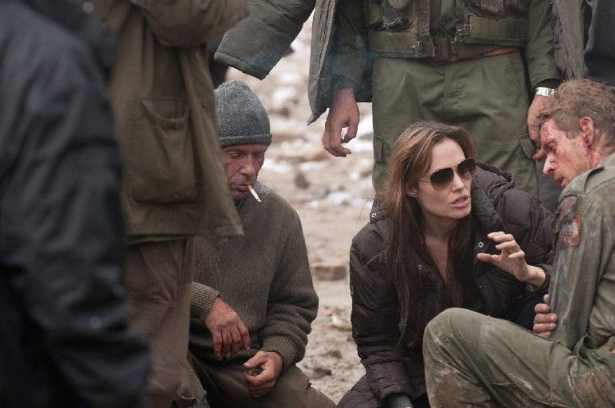 """Director Angelina Jolie, talking with actors in """"In the Land of Blood and Honey,"""" says she doesn't think of the film, which she also wrote, as having a partisan tilt in the ethnic strife endemic to Bosnia. (Film District via Associated Press)"""
