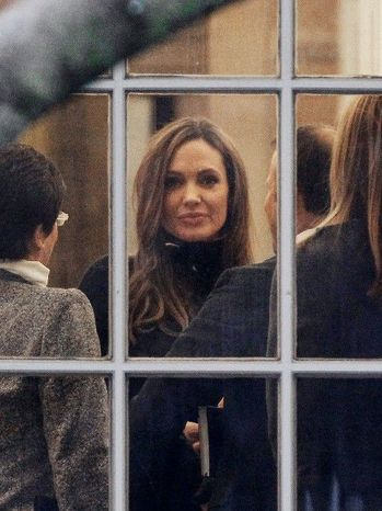 While in Washington to promote her movie about violent ethnic conflict set in the Bosnian war of the early 1990s, Miss Jolie visits the Oval Office on Wednesday for a meeting with President Obama. (Associated Press)