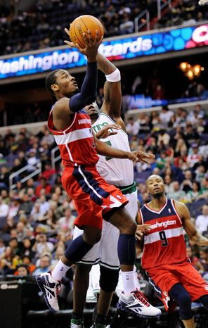 Wizards point guard John Wall has struggled this season, but coach Flip Saunders said Wall had his best game running the team in a win over Toronto on Tuesday. (Associated Press)