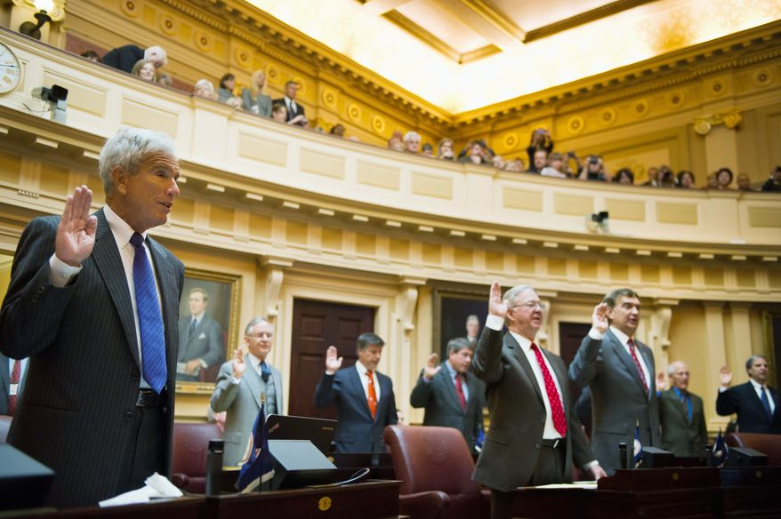 Sen. Richard L. Saslaw (left) is sworn in with the rest of the Virginia Senate on the first day of the 2012 General Assembly session. Not long after, Mr. Saslaw, Fairfax Democrat, was involved in the back-and-forth with Republicans about divisions of power caused by the 20-20 split in the upper chamber. (Andrew Harnik/The Washington Times)
