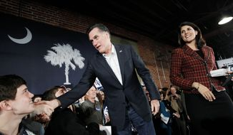 """Former Massachusetts Gov. Mitt Romney and South Carolina Gov. Nikki R. Haley campaign at the Hall at Senate's End in Columbia, S.C., on Wednesday. Mr. Romney took aim at President Obama on the stump, saying he is in """"over his head."""" (Associated Press)"""