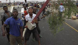 Angry youths protest Jan. 11, 2012 at Lekki road on the third day of a nationwide strike following the removal of a fuel subsidy by the government in Lagos, Nigeria. (Associated Press)