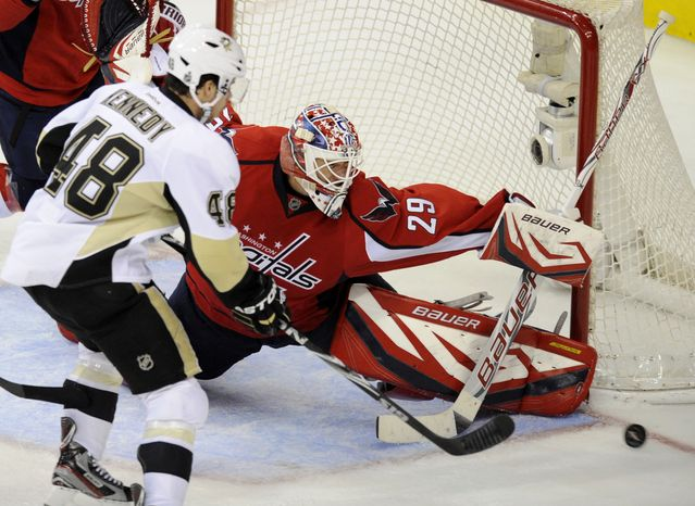 Washington Capitals goalie Tomas Vokoun (29) defends the goal against Pittsburgh Penguins center Tyler Kennedy (48) during the third period of an NHL game, Wednesday, Jan. 11, 2012, in Washington. The Capitals won 1-0. (AP Photo/Nick Wass)