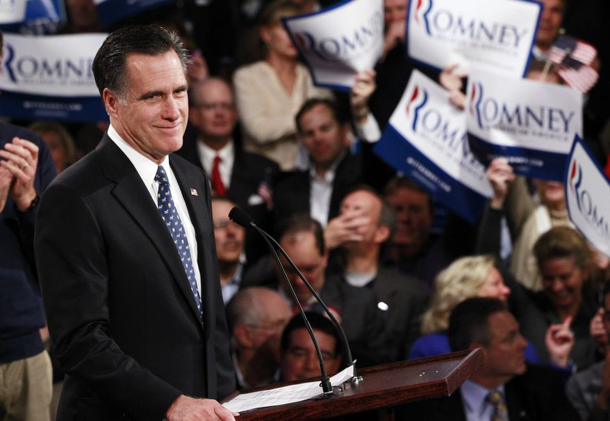 Former Massachusetts Gov. Mitt Romney celebrates his win in the New Hampshire primary election in Manchester, N.H., on Tuesday, Jan. 10, 2012. (AP Photo/Charles Dharapak)