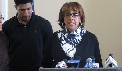 Jocelyn Jennings Nelson (right), the grandmother of missing 18-month-old boy Amir Jennings, asks anyone who might know where the boy is to call police while her nephew Caesar Stovall (left) listens during a press conference Jan. 6, 2012, in Columbia, S.C. (Associated Press)
