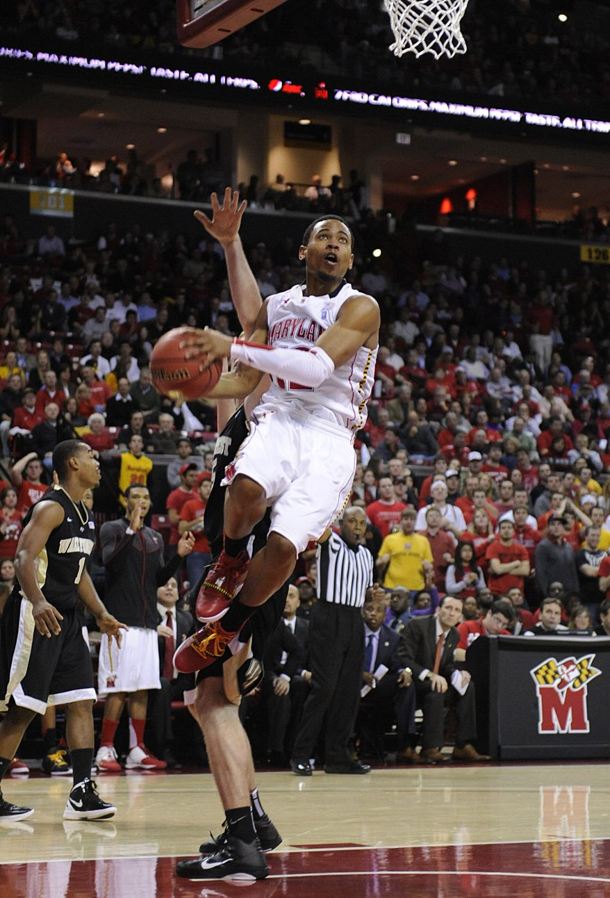Maryland's Terrell Stoglin drives to the basket as Wake Forest's Nikita Mescheriakov, partially blocked, defends in the second half of an NCAA basketball game, Wednesday, Jan. 11, 2012, in College Park, Md. Maryland won 70-64. (AP Photo/Gail Burton)