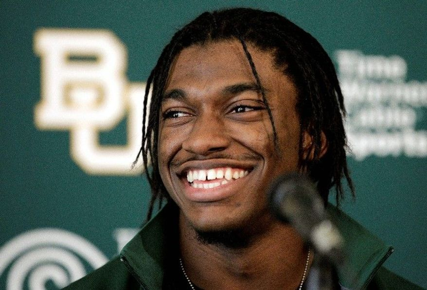 Baylor quarterback Robert Griffin III figures to be a dynamic selection for whatever team takes the Heisman Trophy winner in the April draft. (Associated Press)