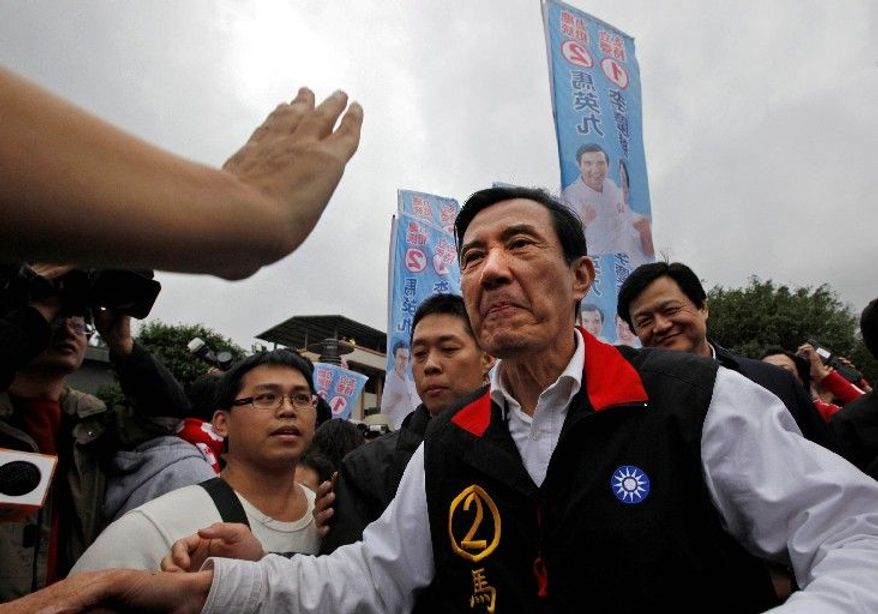 President Ma Ying-jeou (left) is greeted by supporters at an election rally Thursday in New Taipei City, Taiwan. Mr. Ma is being challenged in Taiwan's presidential election by Tsai Ing-wen (right). Ms. Tsai's party rejects unification with China.