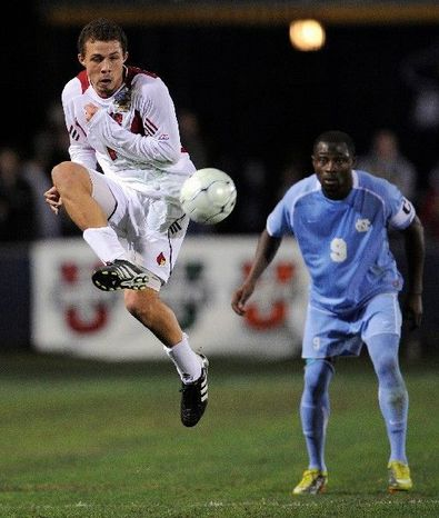 Nick DeLeon (left), shown in 2010, notched six goals and six assists in leading Louisville to the NCAA quarterfinals this past season. He was taken by United with the seventh pick. (Associated Press)