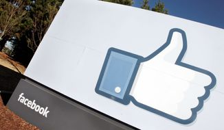 The Facebook logo is prominently displayed outside of Facebook's new headquarters in Menlo Park, Calif. If Facebook goes public this year, as has been speculated, the state stands to reap hundreds of millions of dollars in capital gains taxes from Facebook investors and employees profiting from stock sales. (Associated Press)