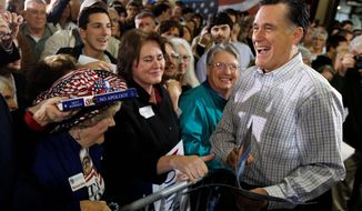 ** FILE ** Former Massachusetts Gov. Mitt Romney, a Republican presidential candidate, campaigns at Cherokee Trike and More in Greer, S.C., on Thursday. (Associated Press)