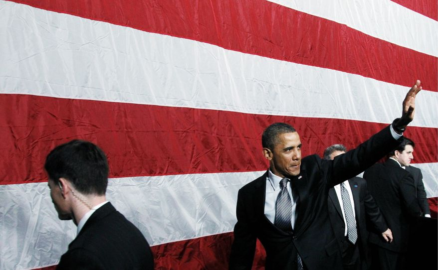 President Obama waves as he leaves after speaking at a campaign event at the University of Illinois at Chicago on Wednesday. With at least five more fundraisers this week, Mr. Obama added to his already hefty campaign warchest. (Associated Press)