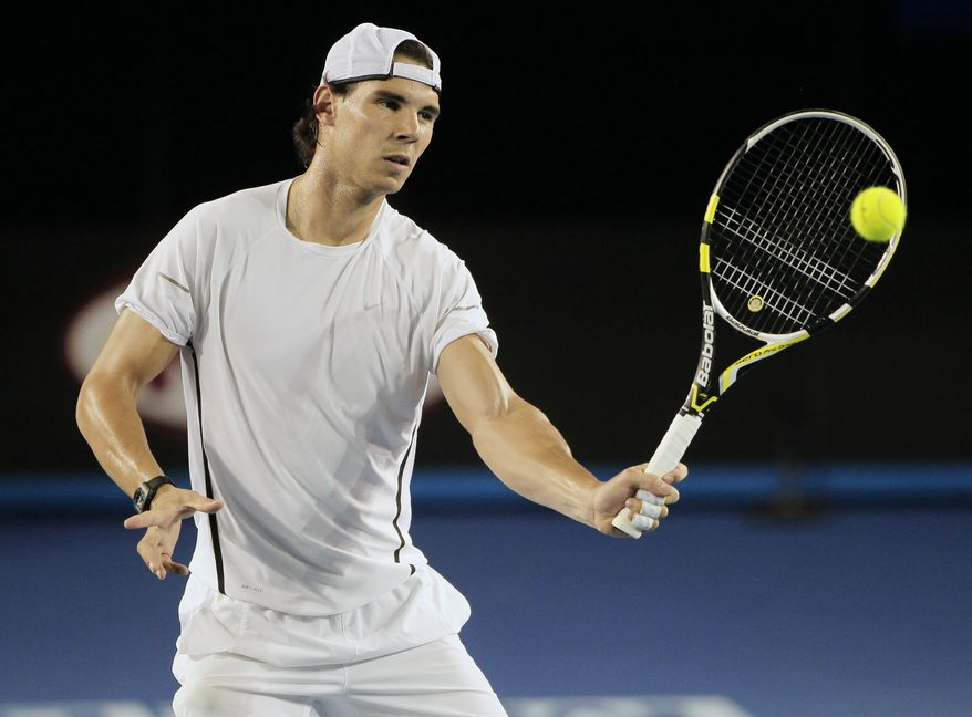 Spain's Rafael Nadal makes a forehand return during a practice session for the Australian Open in Melbourne, Australia, Thursday, Jan. 12, 2012. (AP Photo/Mark Baker)